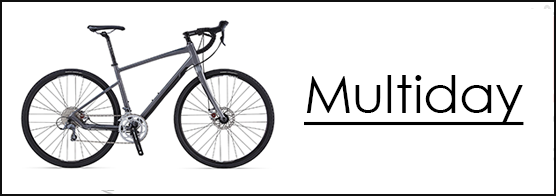 Photo of a road bike and the words Multiday for bike tours with Argan Sports