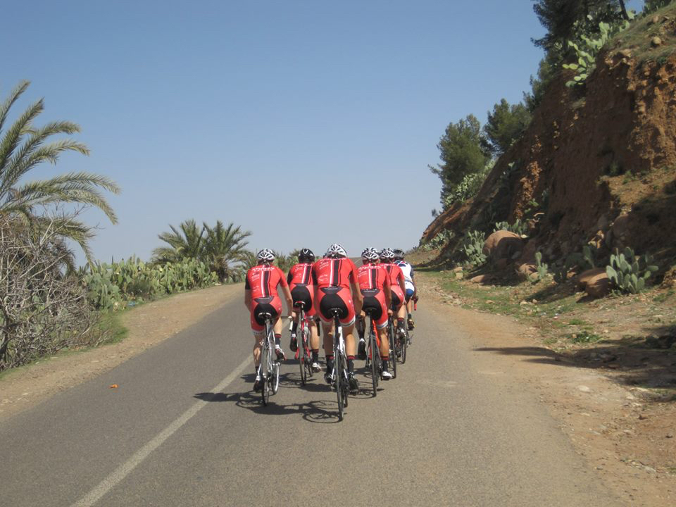 Image of 7 bikers with Argan Sports from behind as they ride the Atlas Mountain Base Ride with AXS Bike Marrakech