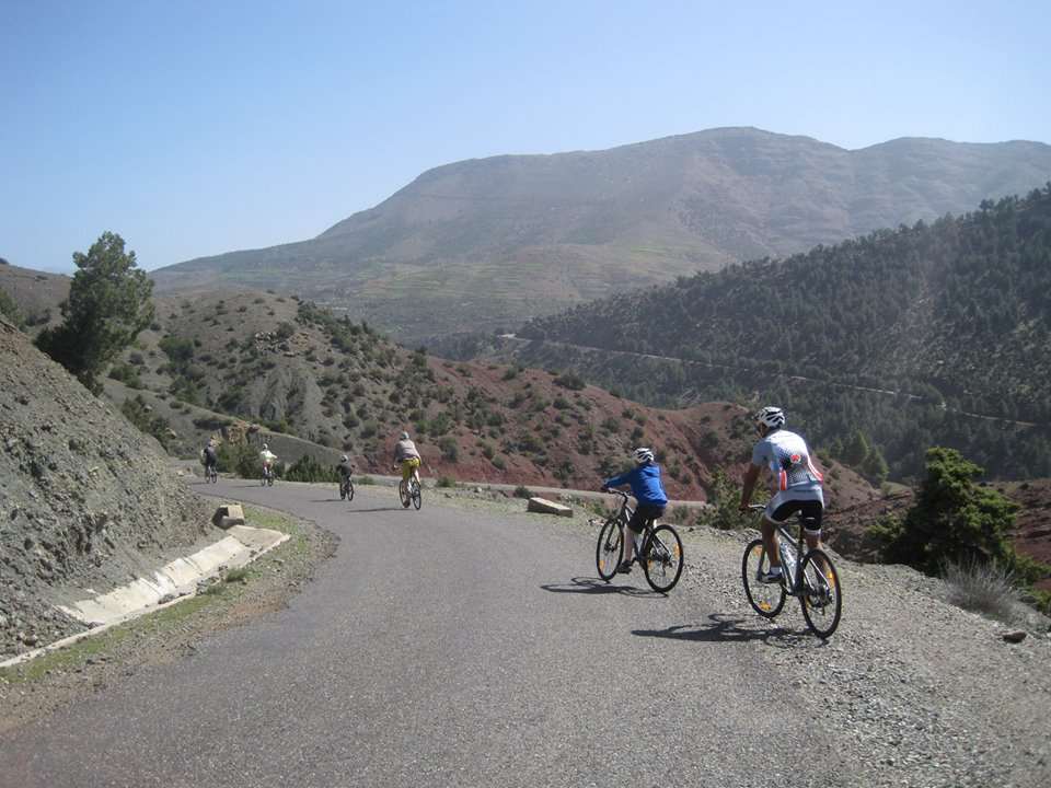 Picture of a family on bikes with Argan Sports as they pass down a silent road with Argan Sports near Marrakech in the Atlas Mountains