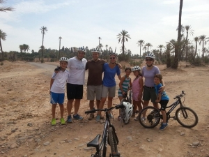 A photo a family of 8 doing an AXS bike tour in the desert