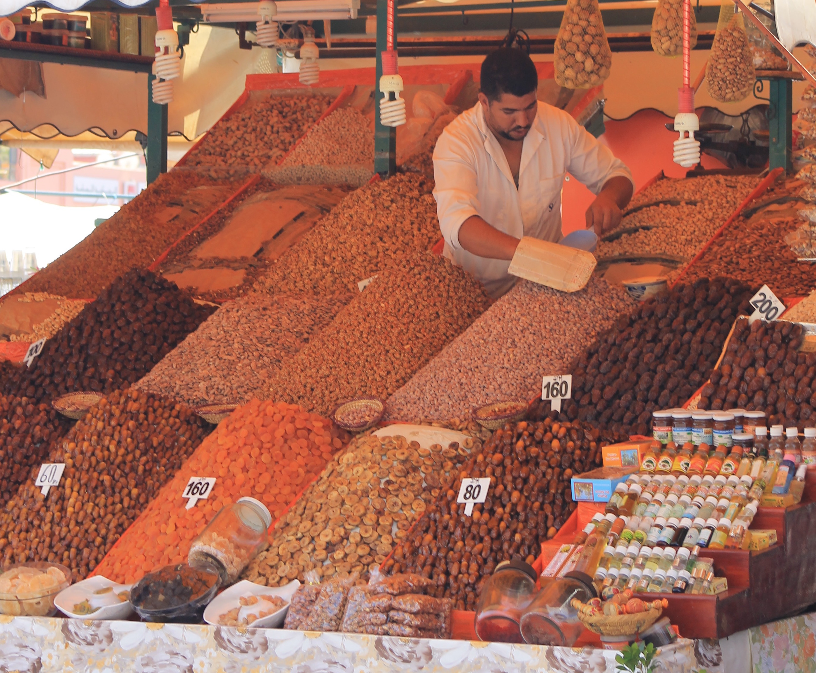 Argan Sports tasting tour man selling sweets in the souk