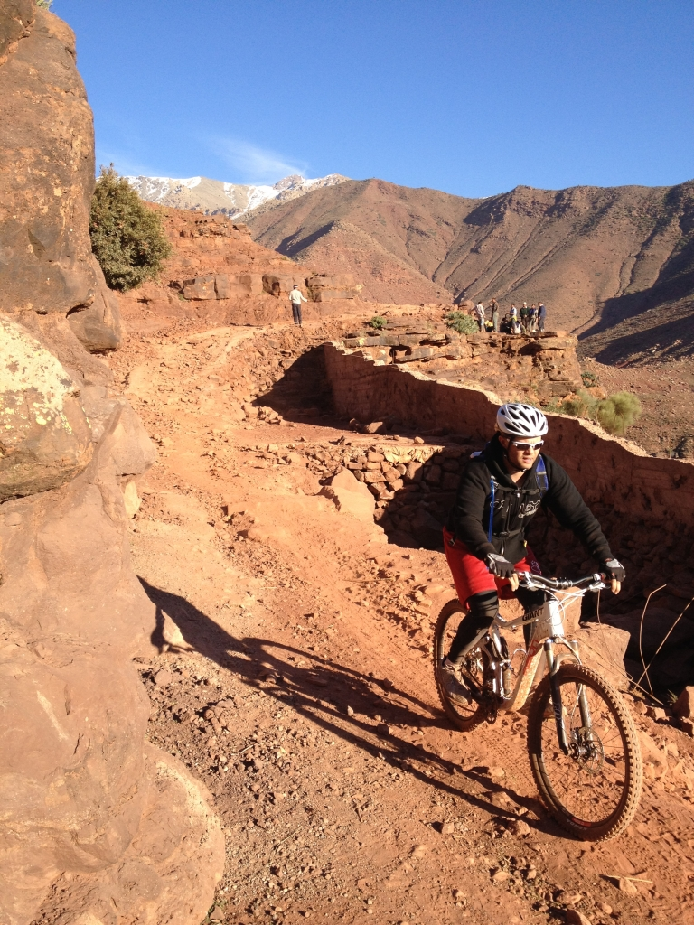 Picture of a single biker winding down a mountain pass on a MTB with Argan Sports