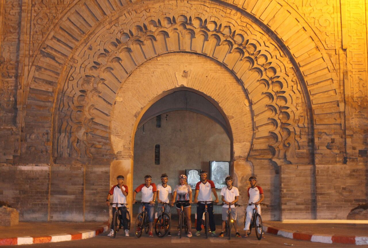 AXS Night bike tour in front of Marrakech City Gate