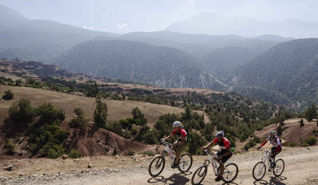3 Bikers passing through a trail in the high Atlas Mountains with Argan Sports
