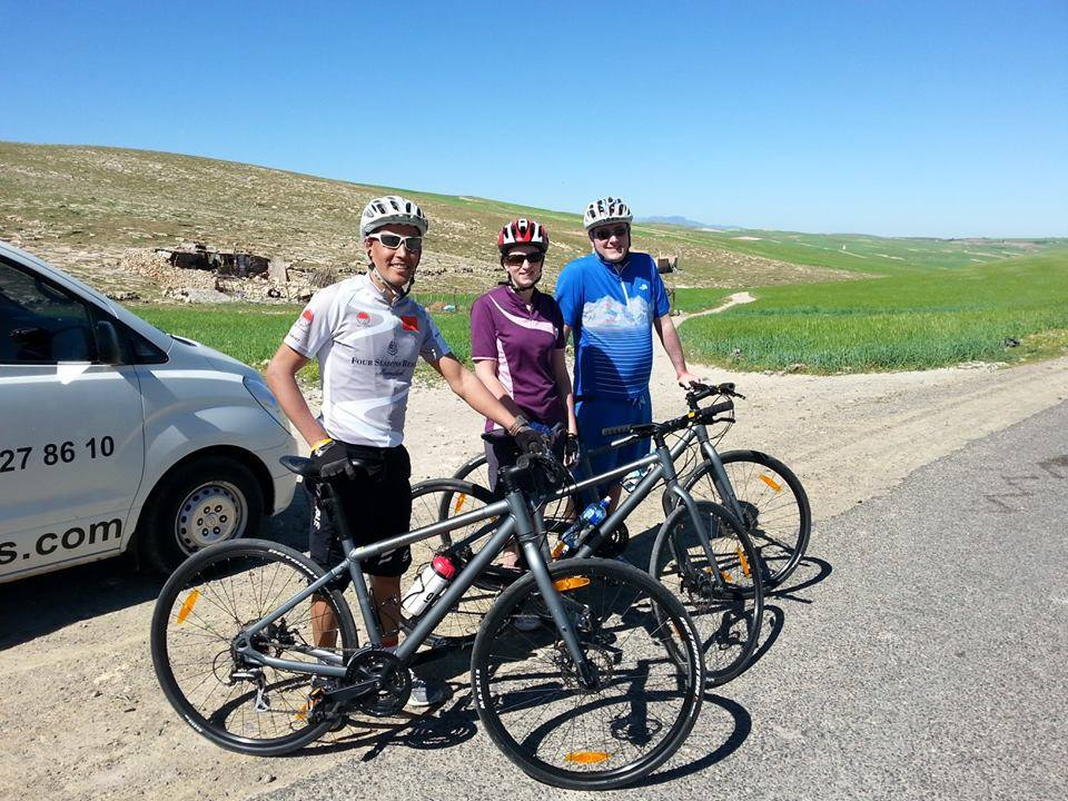 Photo of a couple and a local guide from Argan Sports getting ready to do an easy ride in the Atlas Mountains