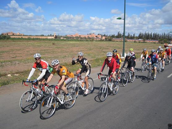 Group of cyclists riding with Argan Sports