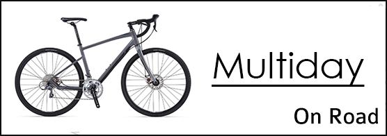 Picture of a touring bike and the words multiday on roa